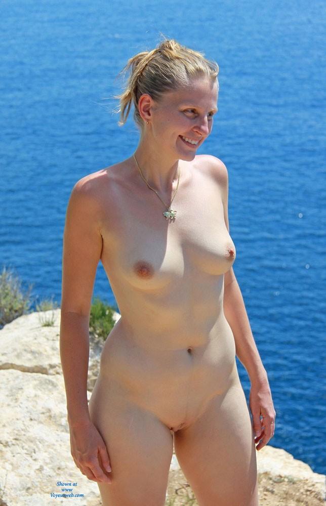 Pic #8 Bri Enjoying Nudity at Portals Vells - Shaved, Medium Tits, Blonde, Beach
