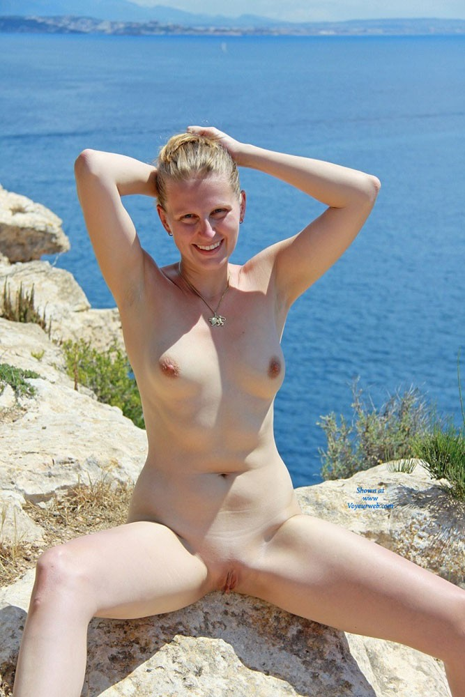 Pic #9 Bri Enjoying Nudity at Portals Vells - Shaved, Medium Tits, Blonde, Beach