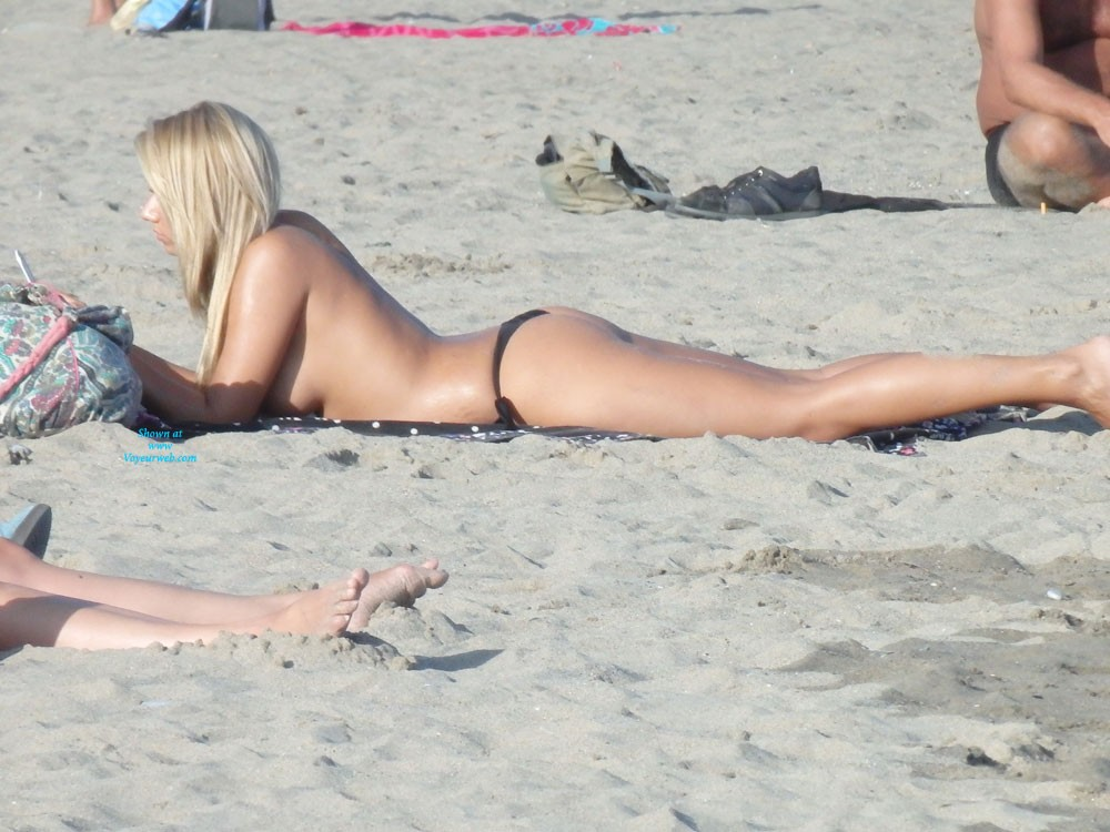 Eye Poppin Beach at Costa del Sol 2013 #2 - Blonde Hair, Beach Voyeur , Does Anyone Else Find It Surprising That Out Of 630,000 People Who Viewed My Last Post, Only 5 Took Me Up On The Suggestion To Let Me Know Which Girls You Wanted To See More Of?  That's Less Than 1 In 100,000!  Anyway, I Listened To Those Few Voices And Have Posted More Of One Of The Co-champions, With 3 Votes.  I'm Afraid I Don't Have More Of The Other Co-champion, Picture #9.  She Noticed Me Right Away And Was Reaching For Her Top In The Picture That I Posted.  There's Still Time For Your Voice To Be Heard, If You Want To Look Back At My Last Post (November 18) And Give Your Opinion.