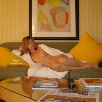 Cxxx: reclining redhead milf naked on couch with robe open