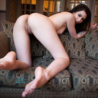 Charlotte Teasing On The Sofa - Brunette Hair, Shaved, Tattoo