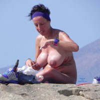 Schwanger in Nude Pose Wearing Headband on Top of Rocks - Big Tits, Brunette Hair, Beach Voyeur