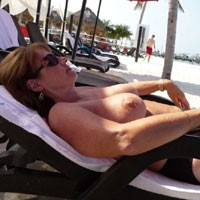 Feeling The Warmth of The Sun - Big Tits, Bikini, Brunette Hair, Exposed In Public, Hanging Tits, Huge Tits, Nude Beach, Nude In Public, Nude Outdoors, Showing Tits, Sunglasses, Beach Tits, Beach Voyeur, Sexy Boobs, Sexy Legs, Sexy Woman