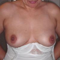 Medium tits of my wife - Laura