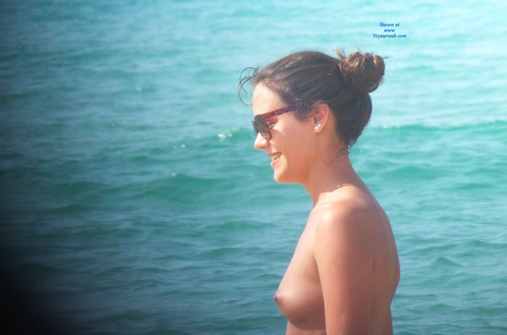 Smiling And Topless In Beach - Brunette Hair, Exposed In Public, Firm Tits, Hard Nipple, Nipples, Nude In Nature, Nude In Public, Showing Tits, Small Tits, Sunglasses, Topless Beach, Topless Girl, Topless Outdoors, Topless, Water, Beach Tits, Beach Voyeur, Sexy Face, Sexy Woman, Young Woman , Brunette, Topless, Nude In Public, Beach, Sunglasses, Firm Tits