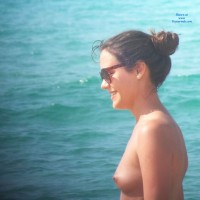 Smiling And Topless In Beach - Brunette Hair, Exposed In Public, Firm Tits, Hard Nipple, Nipples, Nude In Nature, Nude In Public, Showing Tits, Small Tits, Sunglasses, Topless Beach, Topless Girl, Topless Outdoors, Topless, Water, Beach Tits, Beach Voyeur, Sexy Face, Sexy Woman, Young Woman