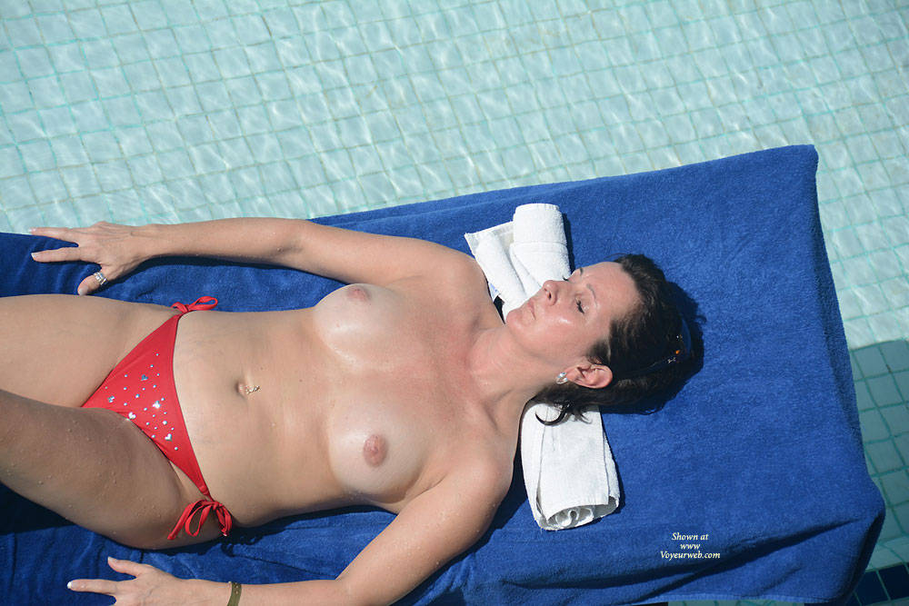 At a Resort in Punta Cana - Brunette Hair , I Saw This Woman Sun Bathing At The Pool.