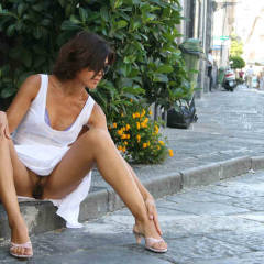 Brunette With Neck Length Hair Wearing Sunglasses, White Dress And No Panties With Spread Legs - Brunette Hair, Long Legs, Spread Legs, Sunglasses , Upskirt On Public Street, White Sun Dress, Pantyless Summer Dress, Sitting On The Curb, Hairy Bush And Long Legs, Exposed In Public, Blue Bra, Hairy Pussy, Biege Medium Heeled Sandals