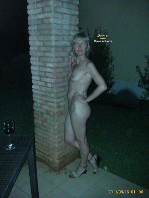 Naked on the apartment's verandah