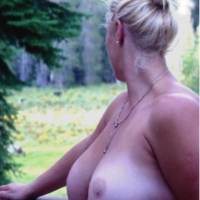 Very large tits of my wife - les