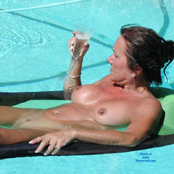 Chilling Naked At The Pool - Big Tits, Brunette Hair, Exposed In Public, Full Nude, Milf, Natural Tits, Nipples, Nude In Public, Perfect Tits, Trimmed Pussy, Water, Wet, Sexy Face, Sexy Legs