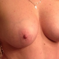 Very large tits of my wife