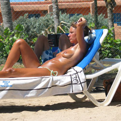 Topless While Enjoying The Sun - Bikini, Brunette Hair, Exposed In Public, Nipples, Nude Outdoors, Showing Tits, Sunglasses, Topless Girl, Topless Outdoors, Topless, Beach Voyeur, Sexy Body, Sexy Girl, Sexy Legs, Sexy Woman