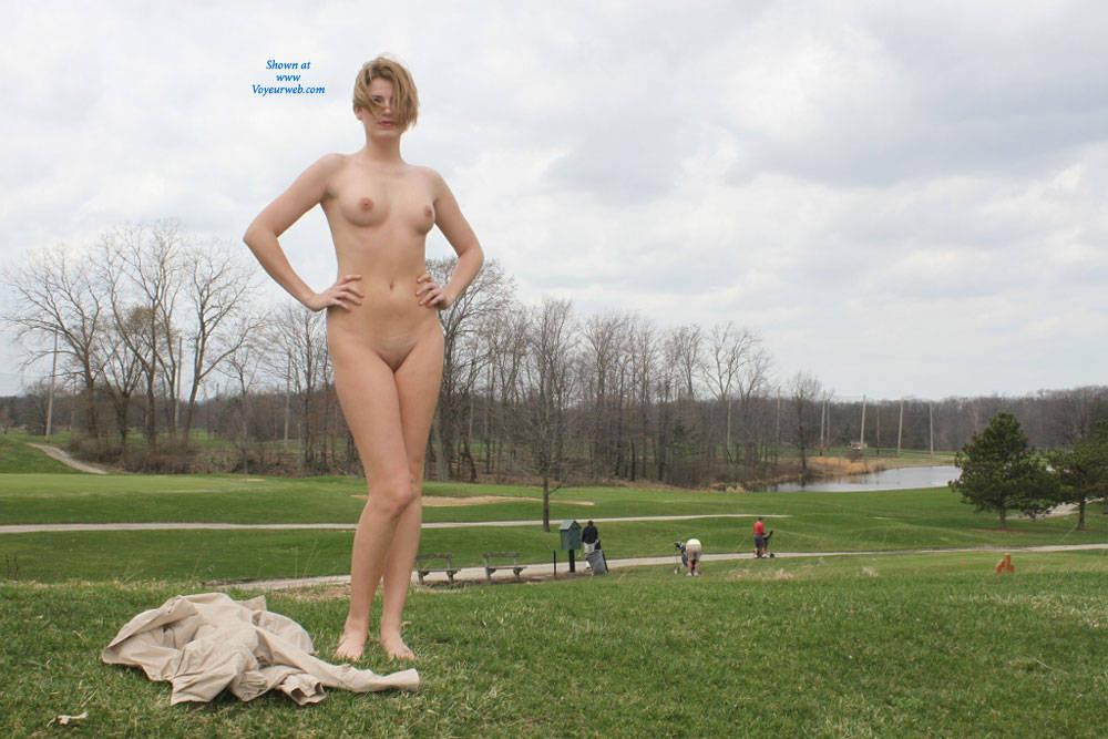 Girl strips nude in public