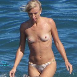 Topless Blonde Enjoying The Beach - Big Tits, Bikini, Blonde Hair, Brown Eyes, Erect Nipples, Exposed In Public, Firm Tits, Hard Nipple, Nipples, Nude In Nature, Nude In Public, Showing Tits, Topless Beach, Topless Girl, Topless Outdoors, Topless, Water, Beach Tits, Beach Voyeur, Sexy Body, Sexy Figure, Sexy Girl, Sexy Legs, Sexy Woman