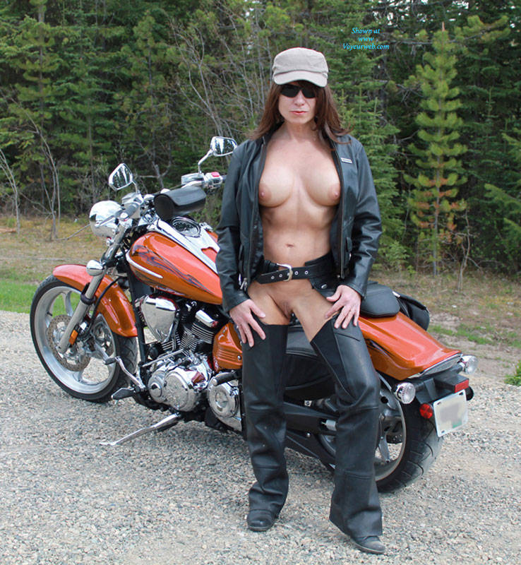 Pic #1 - Biker Babe - Big Tits, Nude In Public, Shaved , Went Out For A Ride And Came Upon This Awesome Spot For A Few Pics.So Naturally As Is My Way I Stripped Down And Struck A Few Poses For The Camera. The Couple Of The Cars That Drove By Enjoyed The Shoot As Well. They Seemed Quite Surprised When They Drove Over The Bridge And Saw Me Naked As The Day I Was Born Posing By The Water. Bad Biker Girl!!! (hehehe) Oh Well. Hope You Enjoy And Vote. Kisses Storm.