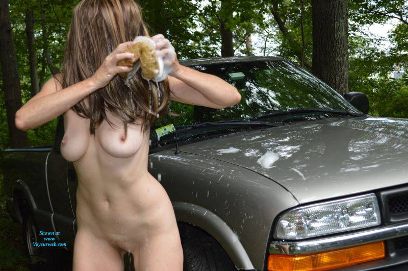 Pic #1 - Sexy Car Wash - Big Tits , There Is Nothing Better Than Watching My Wife Washing The Vehicle. The Way She Shakes Her Ass And Tits While Cleaning.  Mmmm Giving Me A Woody Right Away.  I Can't Wait To Feel That Nice Pussy Of Hers When She Is Done.  If I Can Even Wait That Long. Oh I Want To Feel Those Nice All Natural Titties.....