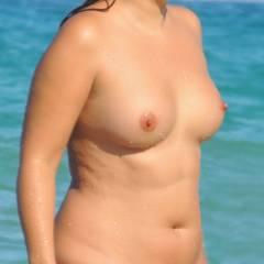 Medium tits of a neighbor - Idania