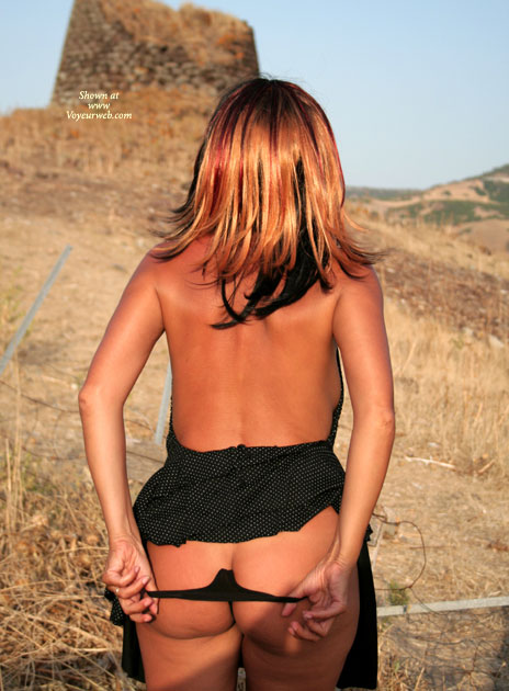 Pic #1 - Girl Raises Skirt And Thong Pulled Down , From Behind, Taking Pants Off During Walk Outside, Black String Under Dress, Panties Down, Black Dress, Raising Skirt And Pulling Down Thong, Pinched Thong, Black String, Black Dress With White Polka Dot Pattern