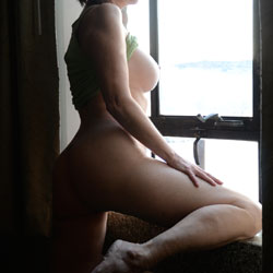 Bent Over At The Window