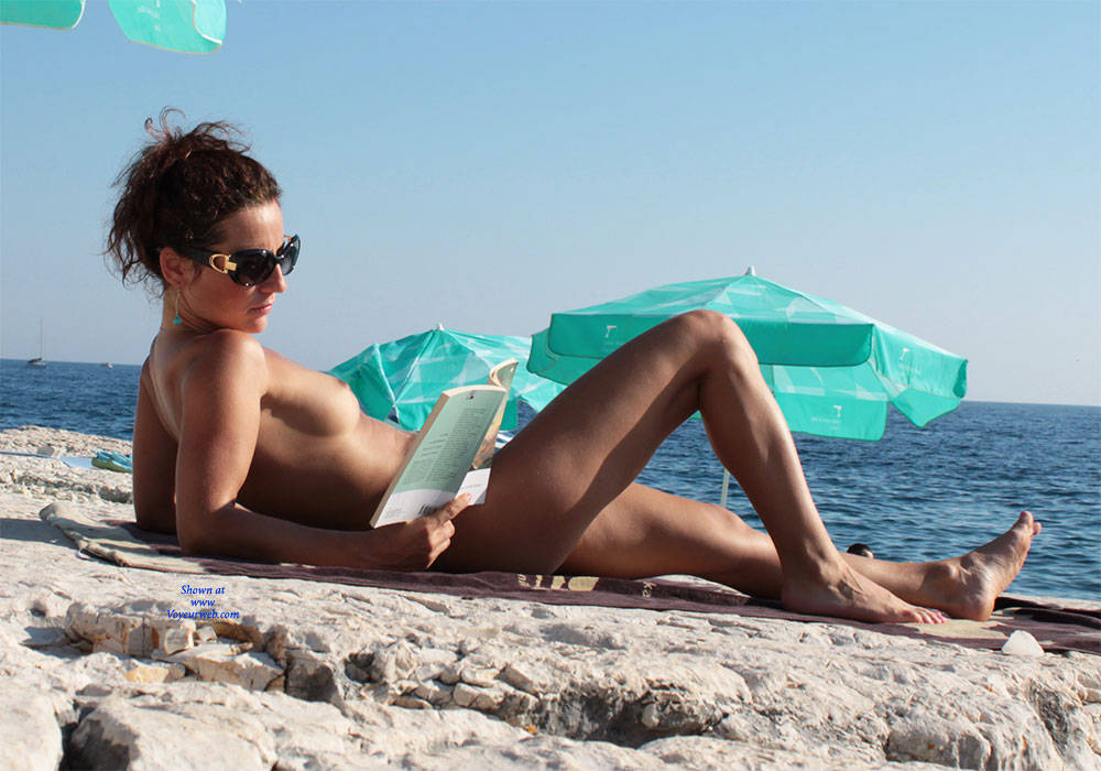 Croatia Island - Beach Voyeur , She Reads In The Sunshine.    After Relax In The Shade ...