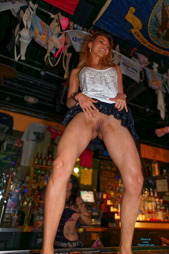 Wife showing pussy in bar