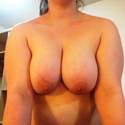 Large tits of a neighbor - laura