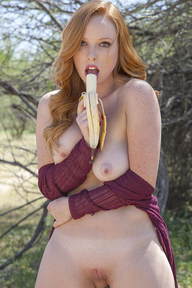 naughty nude redhead eating banana outdoor - june, 2016 - voyeur web