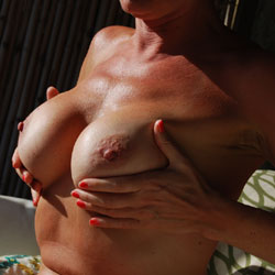 Oiling Up In Hawaii - Big Tits