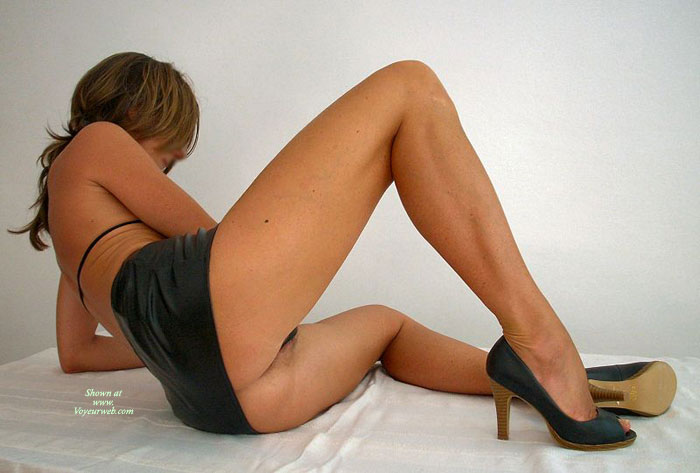Pic #1 - Sexy Girl In Black Micro Mini And High Heels - Heels, Spread Legs , Looking Away, Reclining On A Floor, Black Mini Skirt, Black Leather Miniskirt, Black Halter Top, Black Open Toe Pumps With Wooden Heels, Legs Spread On A Floor, Black Micro Mini, Spread Legs