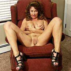 Tramp Stamp In The Red Chair - Mature, Big Tits, Tattoos