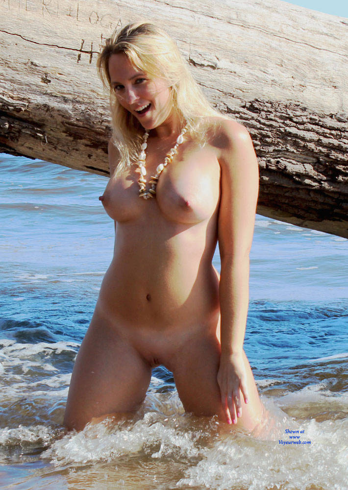 Young naked girl on beach