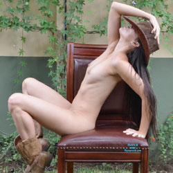Nude Cowgirl On Chair - Big Tits, Boots, Brunette Hair, Chair, Erect Nipples, Navel Piercing, Nipples, Perfect Tits, Naked Girl, Sexy Legs