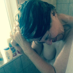 Enjoying A Bath - Brunette, Mature
