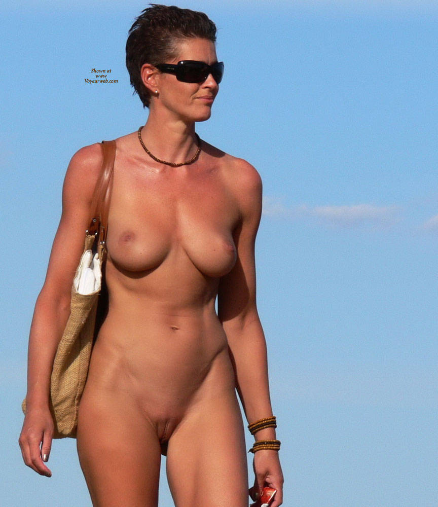 Pic #4 Waiting For The Sun - Big Tits, Brunette, Beach Voyeur, Outdoors, Shaved