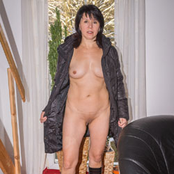 Blach Coat On Black Chair - Brunette, Shaved, Natural Tits