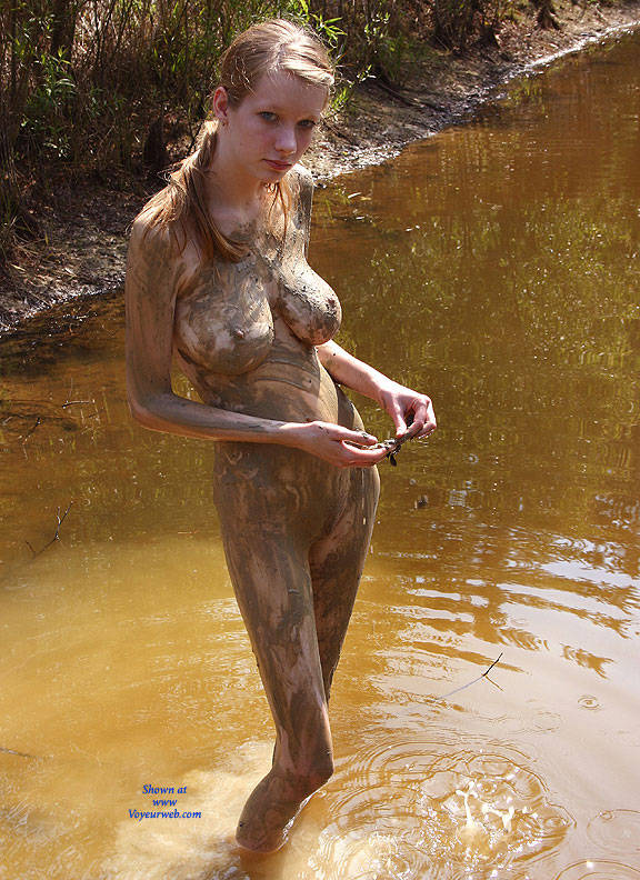 Naked girl in mud are
