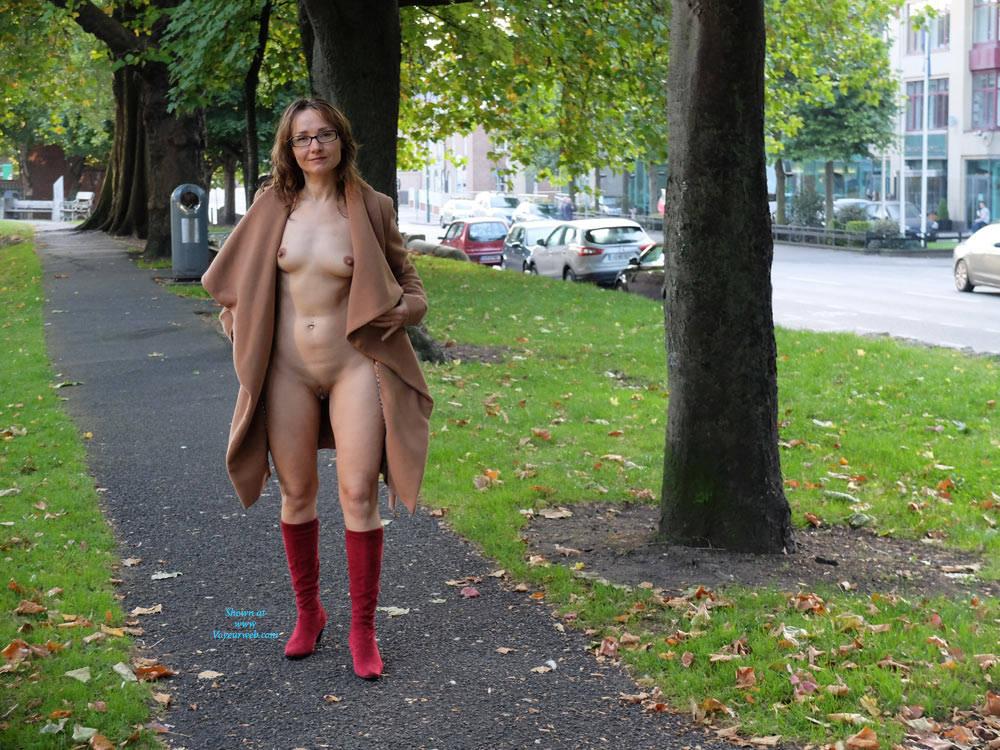 nude woman in raincoat flashing