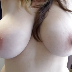 Very large tits of a co-worker - Angie