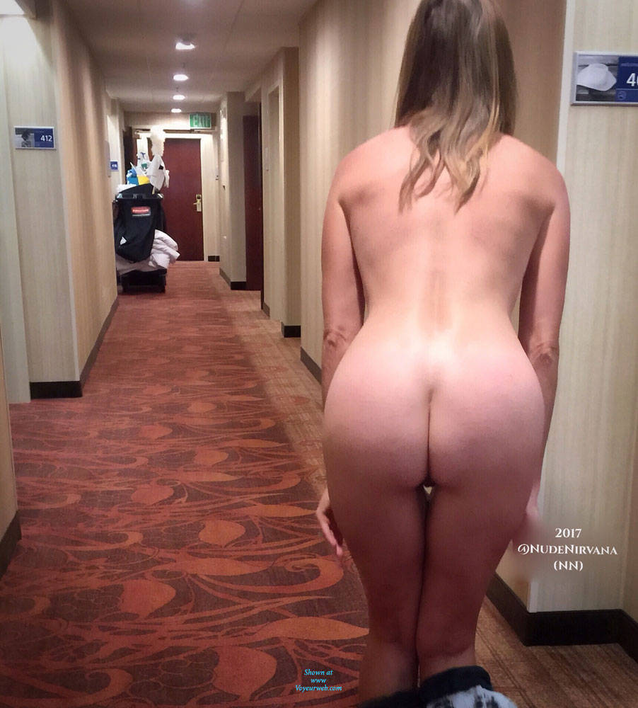 Hallway in naked wife