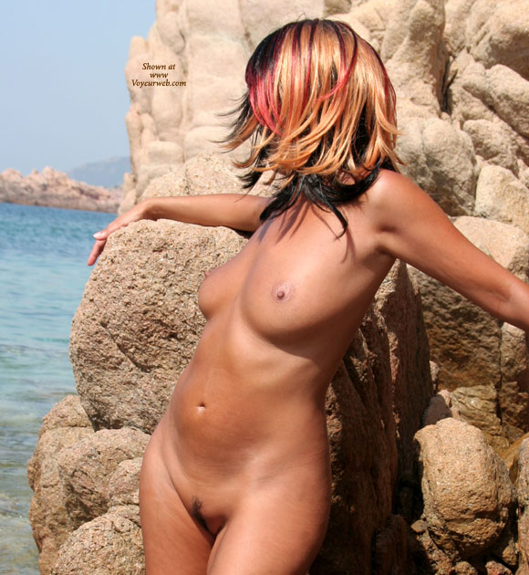 Pic #1 - Half Profile Of Standing Nude Girl - Landing Strip, Natural Tits, Naked Girl, Nude Amateur , Tanned Skin, Light Brown Ariola, Arms Are Outstretched, Posing At The Beach, Head Is Turned Fully Away, Multi Colored Hair, Streaky Hair, All Over Tan