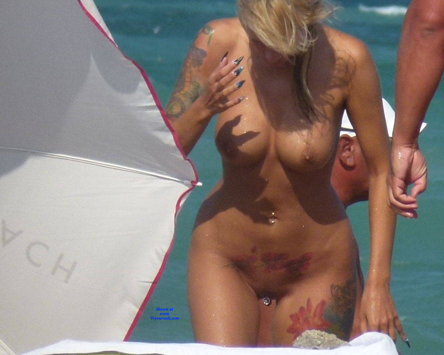 Tattooed nude girl beach