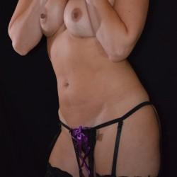 Medium tits of my wife - Anna.