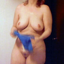 Chubby wife plays with her tits and cums