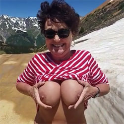 Rubbing Her Boobs On The Snow - Big Tits, Brunette, Outdoors, Amateur