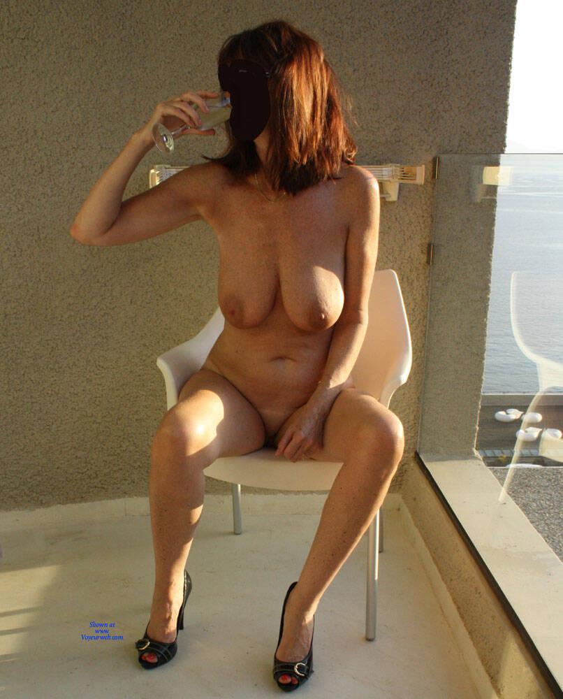 Naked on balcony