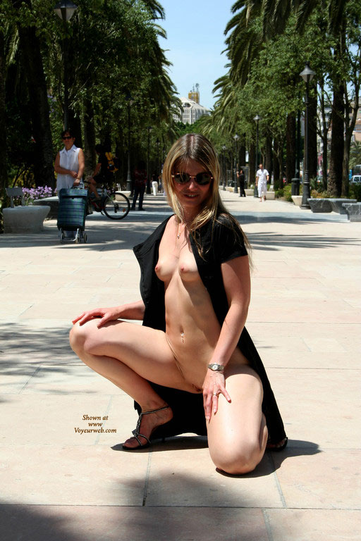 Exposed In Public With People In The Background - Blonde Hair, Flashing, Small Tits, Spread Legs, Looking At The Camera , Exposed In Public, Kneeling Down, Blonde With Small Tits, Flashing In Public, Flashing In A Park, Squatting In The Park With Only A Completely Unbuttoned And Thrown Open Dress On., Dress Opened