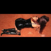 Wife Dressed In Pvc And Boots