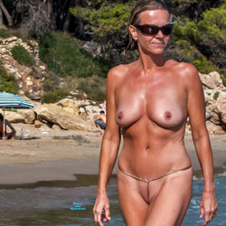Nudist Tanned And Shaved Swinger Milf On The Beach - Big Tits, Milf, Nude Outdoors, Shaved, Beach Voyeur, Naked Girl, Amateur