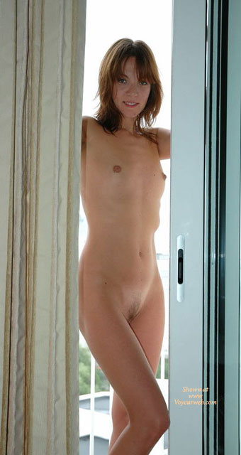 Pic #1 - Naked Girl Standing By A Window - Brown Hair, Hairy Bush, Small Breasts, Small Tits, Naked Girl, Nude Amateur , Full Frontal Nude, Tiny Tits, Young, Balcony Babe, Nude On The Balcony, Flat Chest